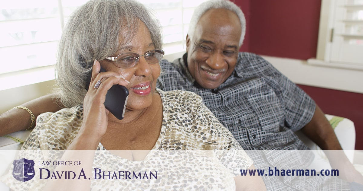 Couple speaking with bankruptcy attorney by phone